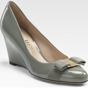 Salvatore Ferragamo Flo wedge pumps $490.00 at Saks Fifth Avenue
